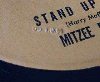 Mitzee Baker embossed stamp code